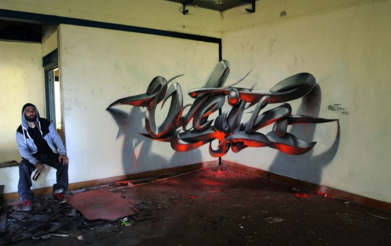 Odeith sitting by mural