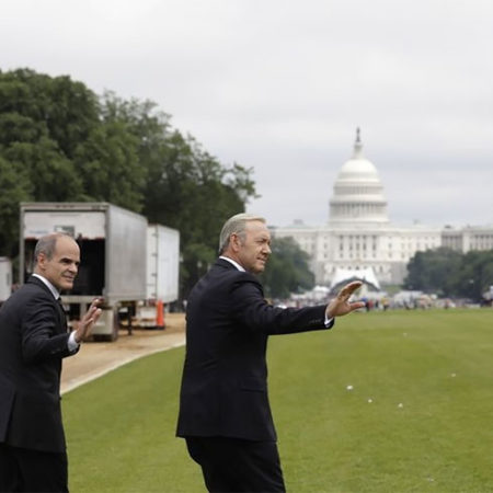 Frank Underwood and his aide wave goodbye.